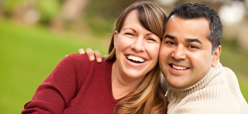 Attractive Mixed Race Couple Portrait in the Park.