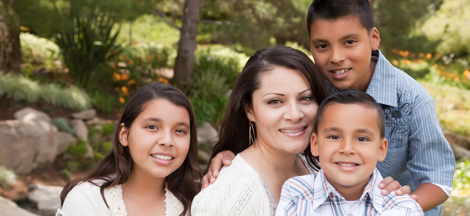 Happy Hispanic Mother and Children in the Park.