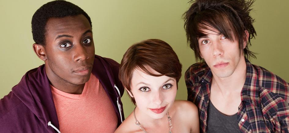 Three urban teens looking up